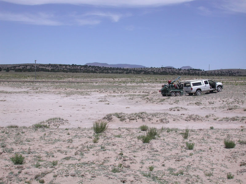 The Ake Folsom site in 2004. The truck is up on the flank of the 2105m shoreline. The southwest track of the VLA is visible in the middle distance. The 1978 excavations were in and along the margins of the flatter, eroded area. (V.T. Holliday).