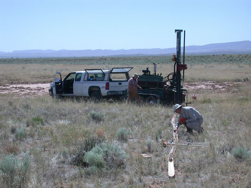 Coring in Chupadera Wash. View is to the  northeast toward the north ridge of Mockingbird Gap (sage brush in middle distance) and Chupadera Mesa (on the skyline).