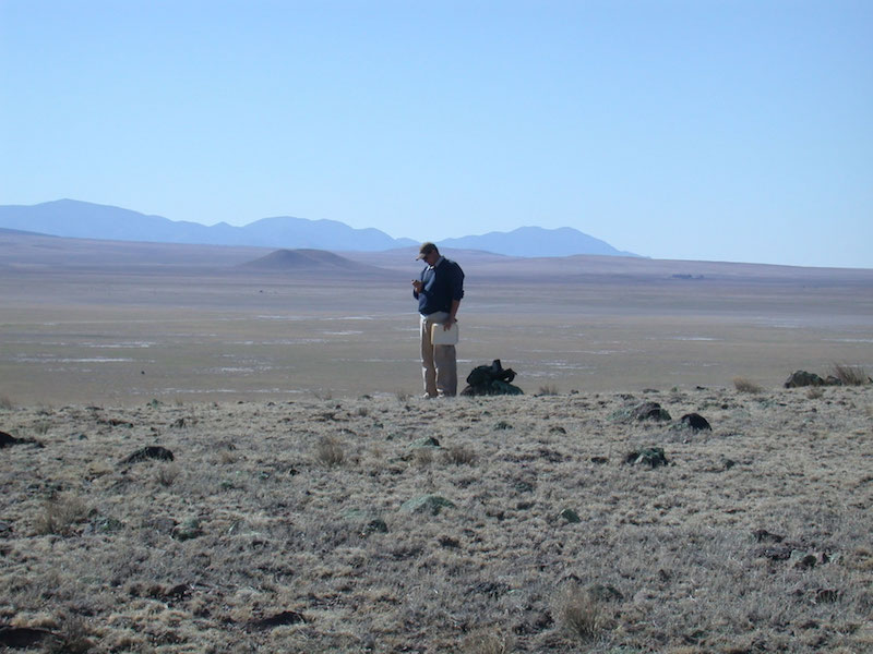 Matt Hill (UA graduate student in Anthropology) overlooking the C-N Basin during his survey of the area (V.T. Holliday).